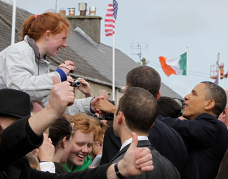 President Obama is greeted by enthusiastic Irish well-wishers during a visit to his ancestral hometown of Moneygall, County Offaly
