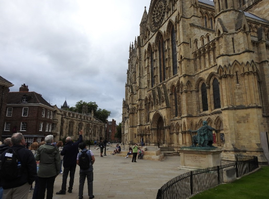Our tour guide, Ian, capturing the attention of our group with the building's history York Minster, York, UK