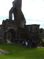Guests enjoying a walking tour of the Abbey at St. Andrew's, Scotland Border