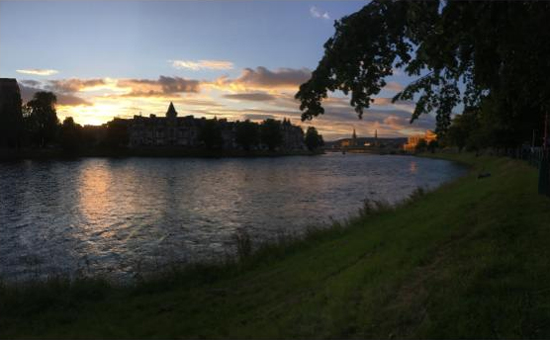 Inverness, Scotland around 9:30 at night with a bright sky