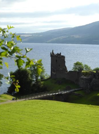 Urquhart Castle sitting next to Loch Ness in Scotland