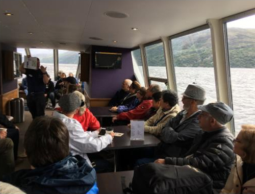 Our cruise guide sharing tales of the Loch Ness Monster to our guests
