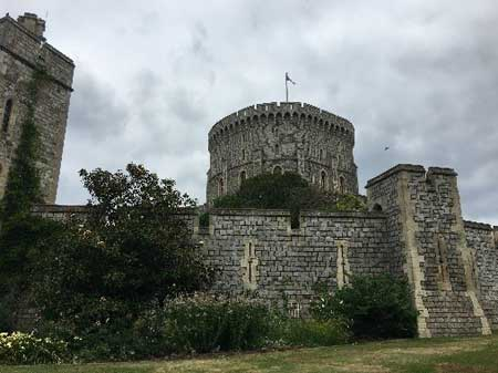 Round tower with flag flying indicating the queen's presence, Windsor Castle